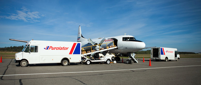 Purolator trucks and plane at airport