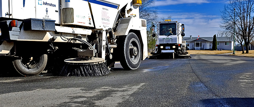 Street sweepers in a residential area of Prince George.