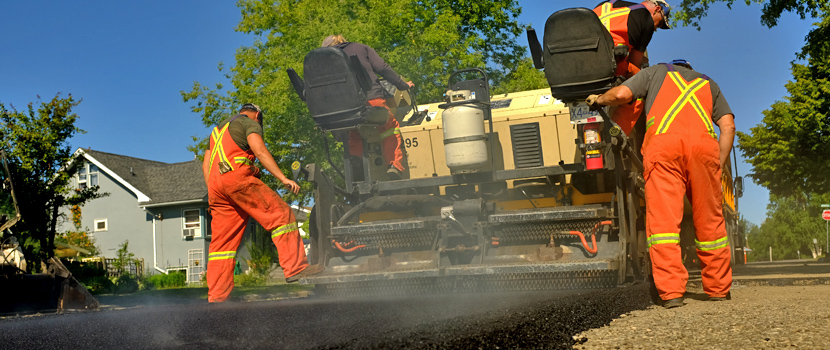 City crews re-pave a residential street in Prince George