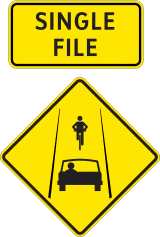 Single file shared roadway sign