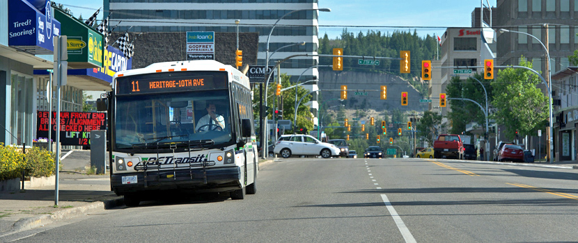 a city bus drives down Victoria Street in Prince George