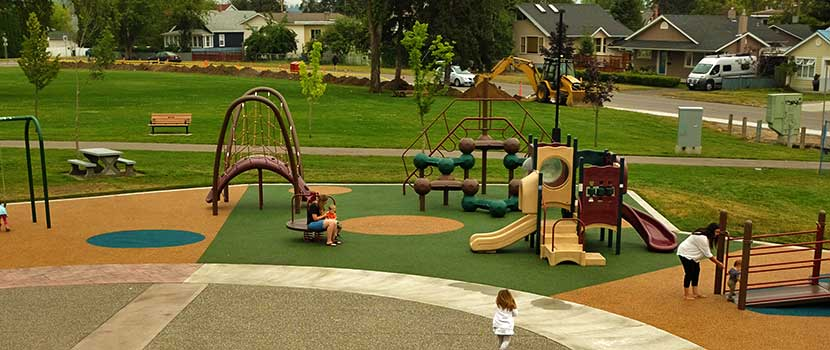Children play at the City's largest accessible playground at Duchess Park