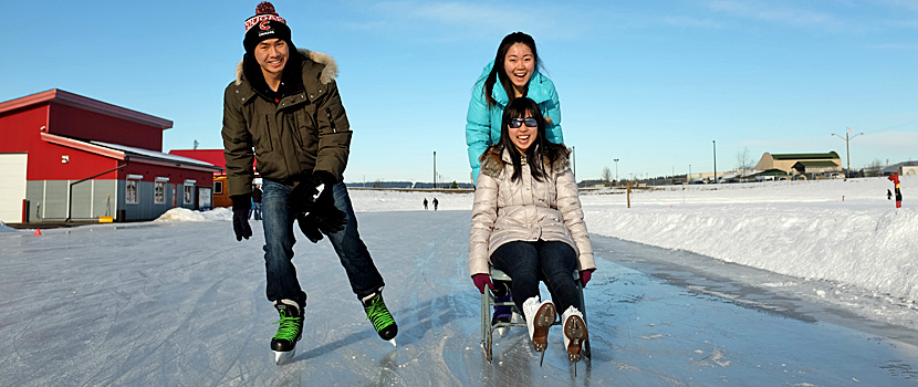 University students enjoying the Outdoor Ice Oval